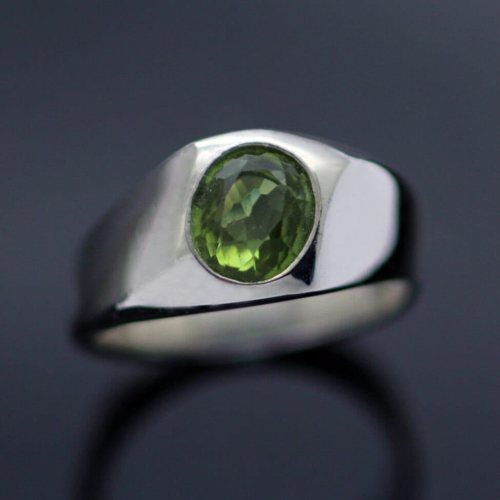 Modern signet ring gemstone oval cut Peridot