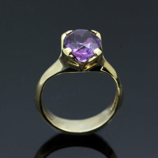Oval cut Amethyst gemstone set in modern 9ct Yellow Gold ring shank