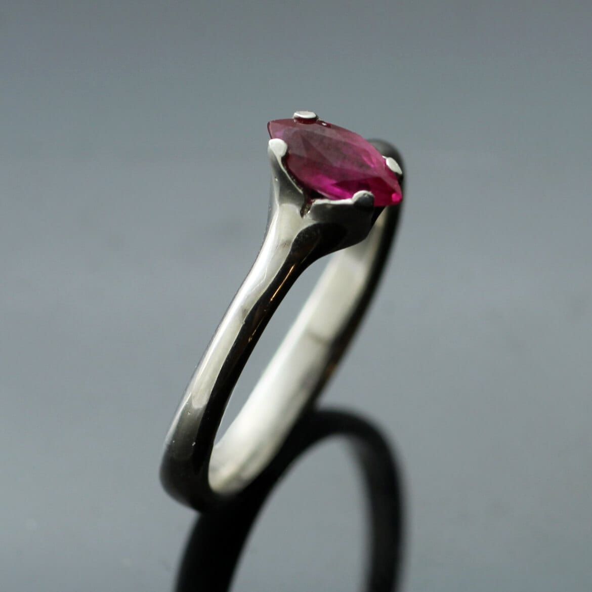 Unique Marquis cut Ruby Flower engagement ring by Julian Stephens