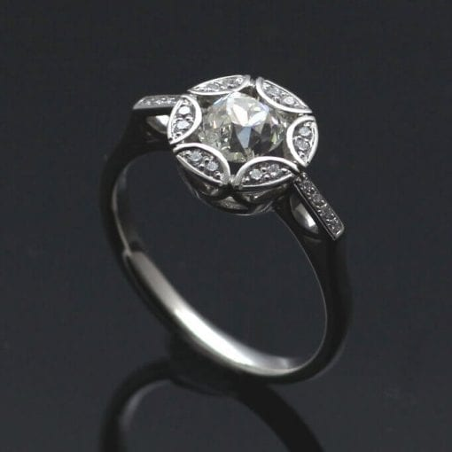 Old Cut Diamond with pave set Diamonds in solid Platinum engagement ring