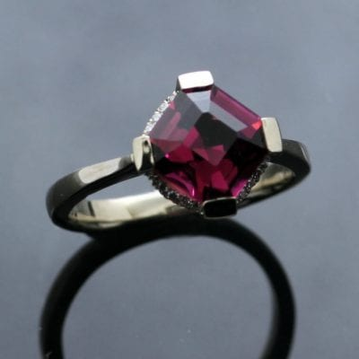 Unconventional, modern gemstone engagement rings by Julian Stephens