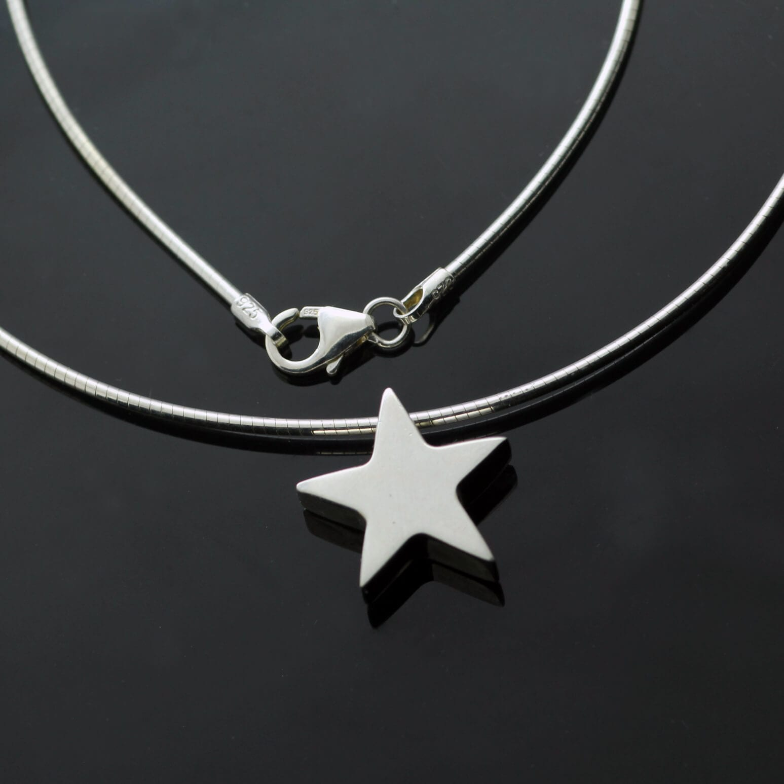 Modern solid Silver handmade star charm pendant on silver snake chain