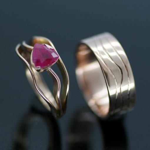 Bespoke Trillion cut Ruby engagement ring with matching White Gold wedding band by Julian Stephens