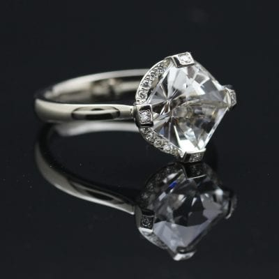 Gatsby engagement ring featuring a contemporary design, handcrafted by Julian Stephens
