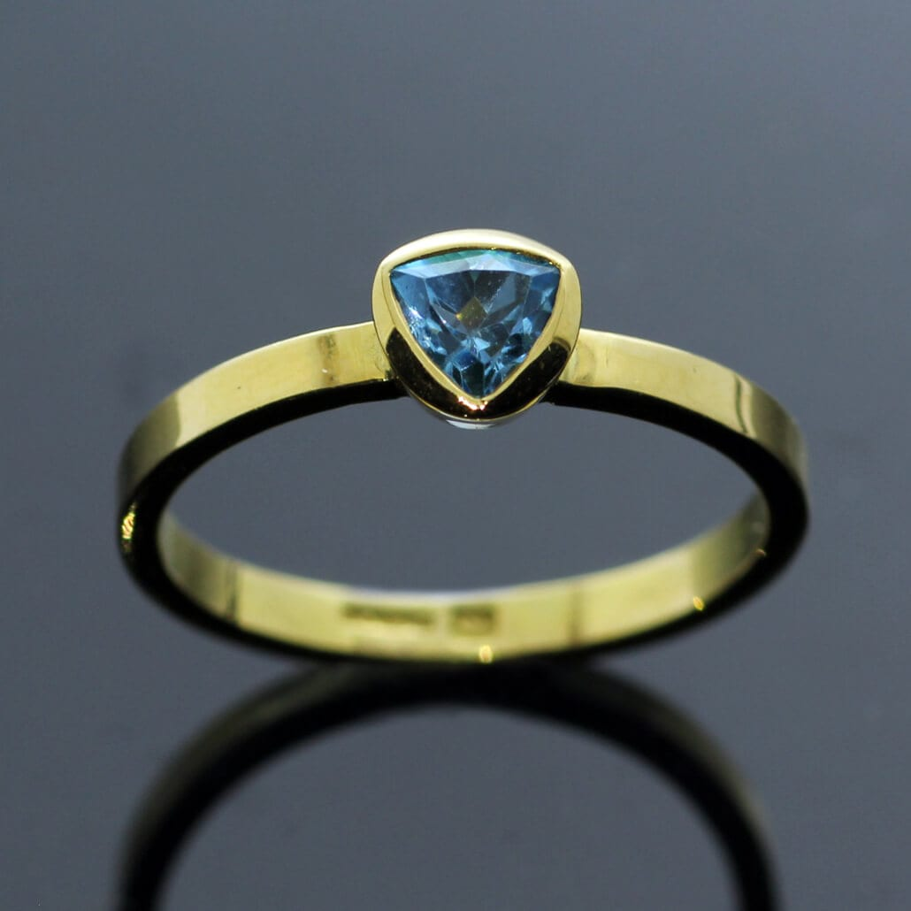 Modern handmade stacking ring Trillion cut Blue Topaz in Yellow Gold