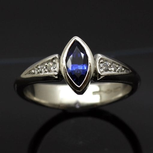 Bespoke, handcrafted Marquis cut Blue Sapphire engagement ring