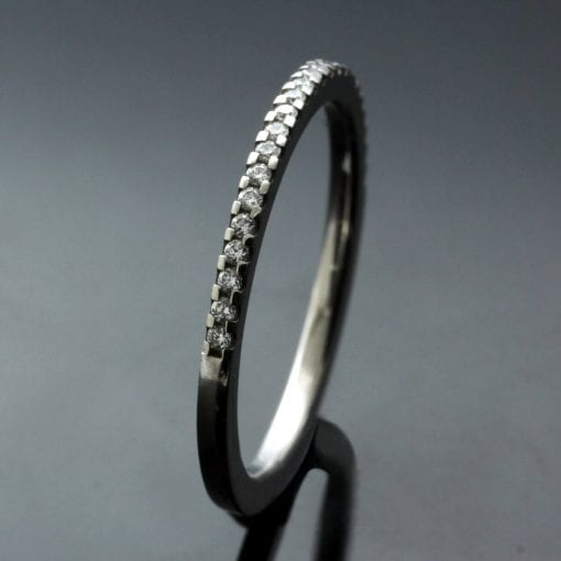 Contemporary half eternity band platinum Diamonds handcrafted design