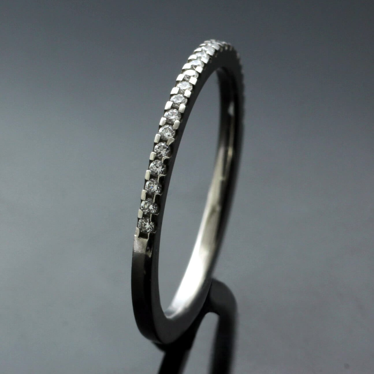 Contemporary half eternity band platinum Diamonds handcrafted design