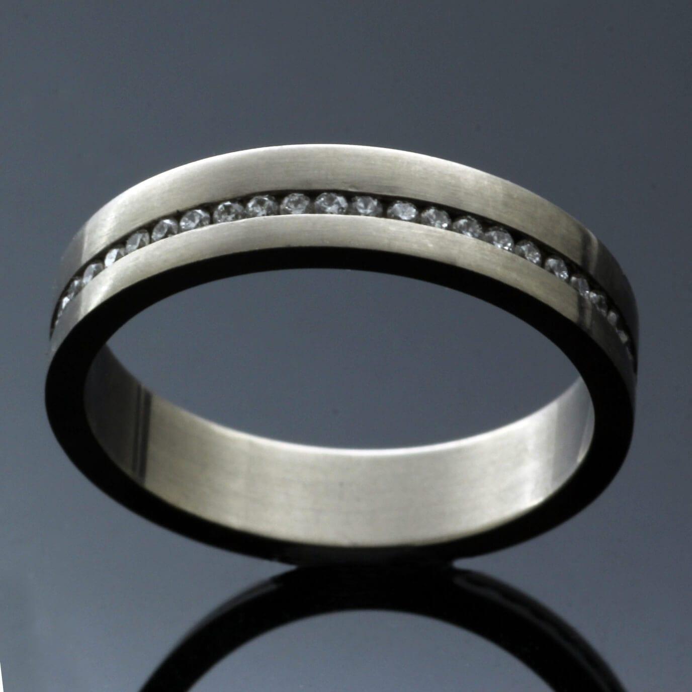 Contemporary handcrafted white gold diamond eternity band unique design