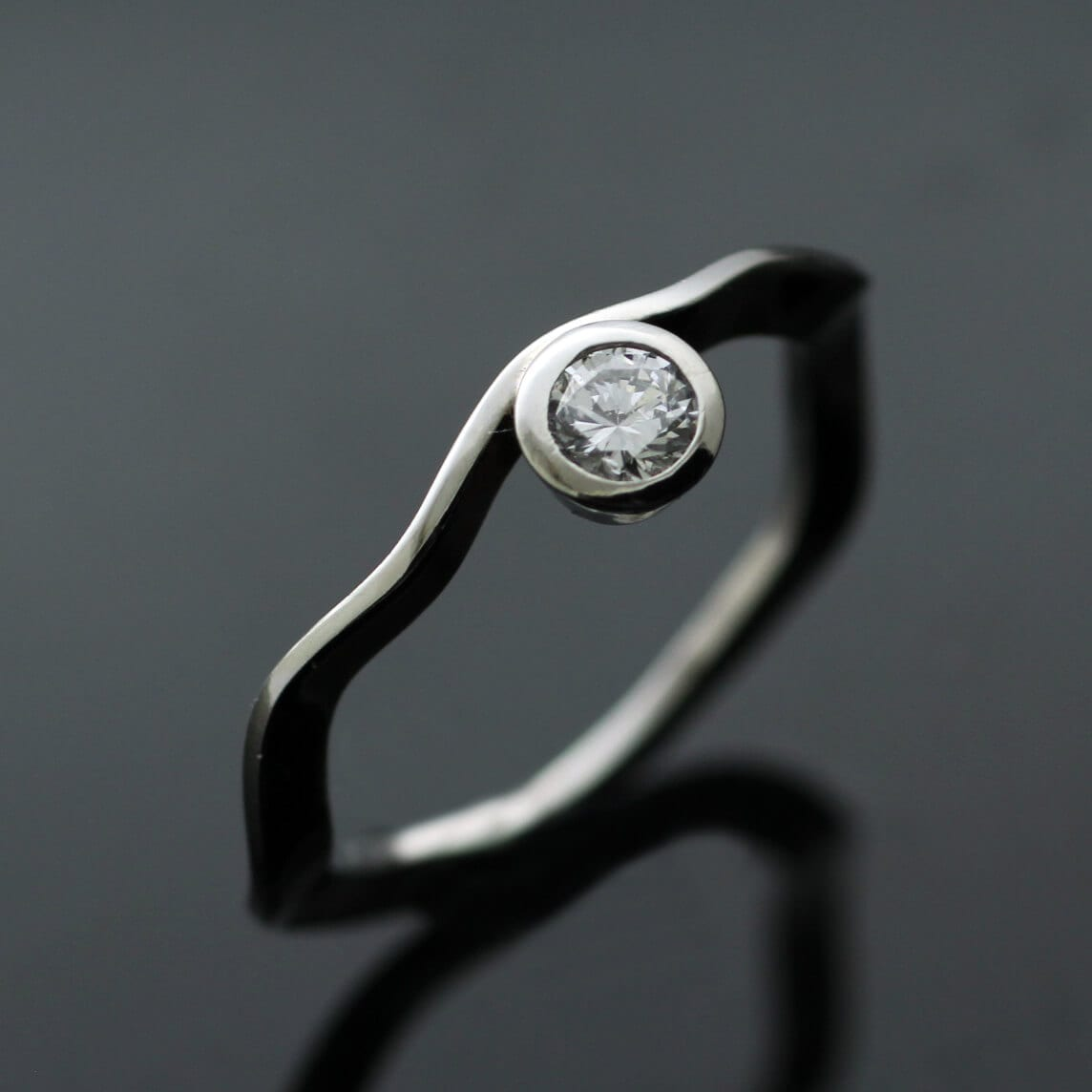 Solitaire Diamond and Platinum contemporary engagement ring from the Ruscello Collection