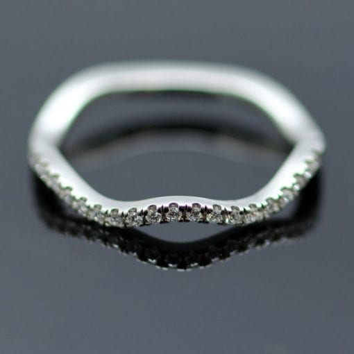 Beautiful wave Platinum and Diamond half ET ring handmade by Julian Stephens