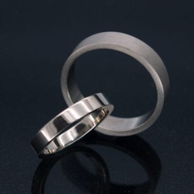 Handcrafted personalised flat wedding bands hand finished in precious metals