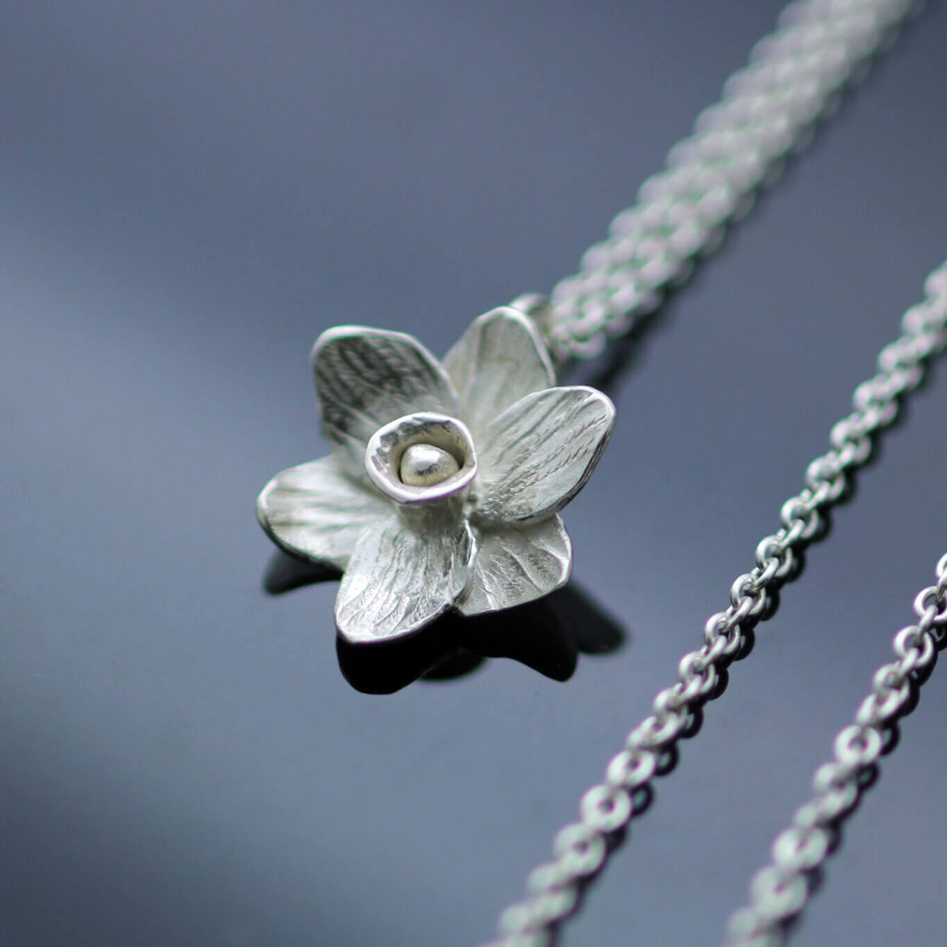 Contemporary unique daffodil floral charm silver necklace