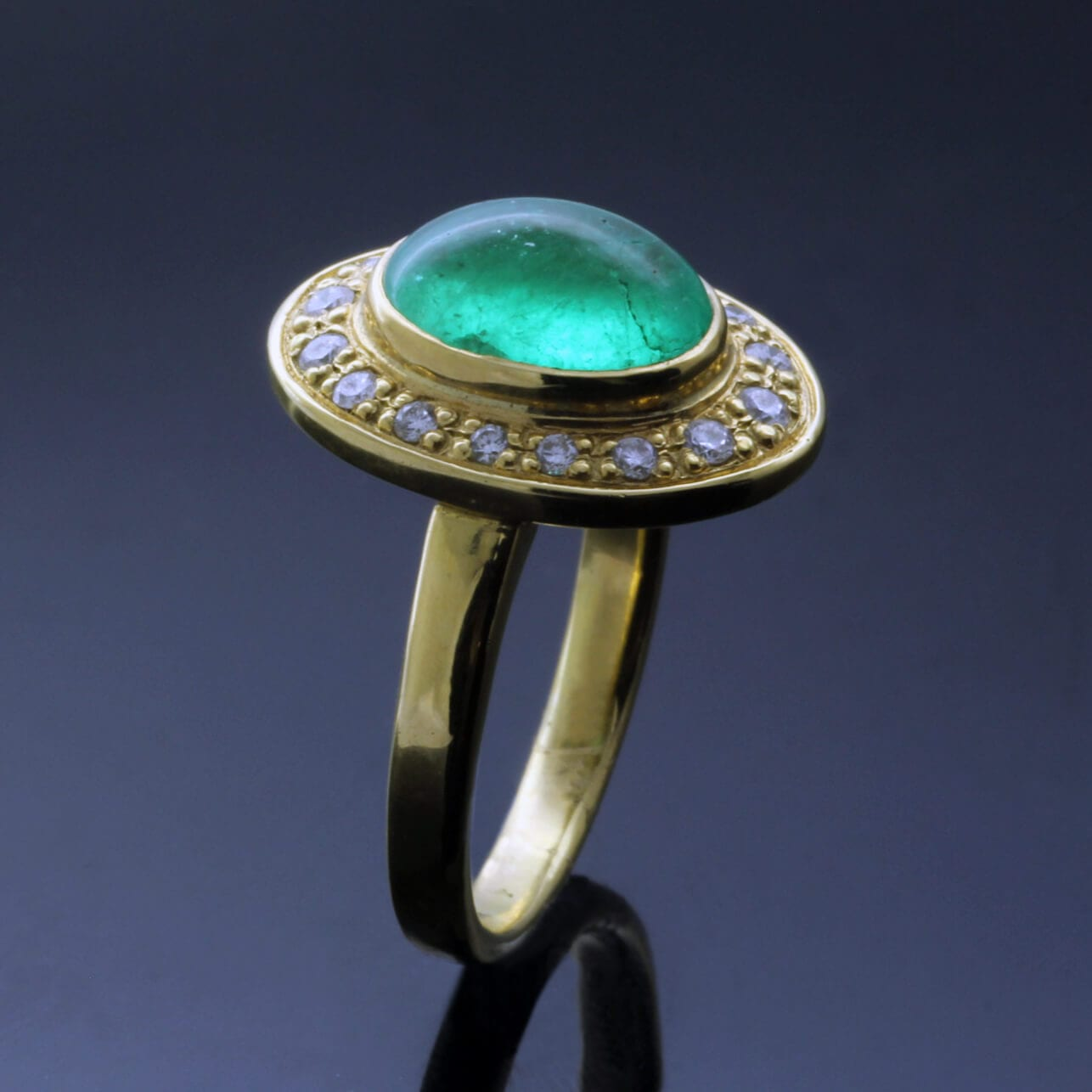 18ct yellow gold cabochon cut Emerald Halo Diamonds modern ring