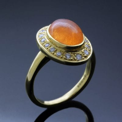 Cabochon cut Mandarin Garnet Halo Diamonds handmade Yellow Gold statement ring