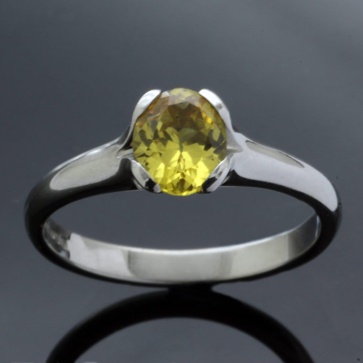 Chrysoberyl gemstone engagement ring set in solid Palladium by Julian Stephens
