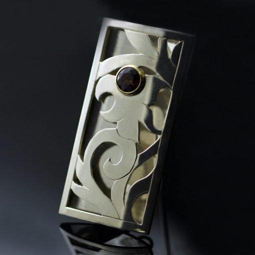 Sterling Silver hand pierced scroll floral motif Garnet gemstone brooch