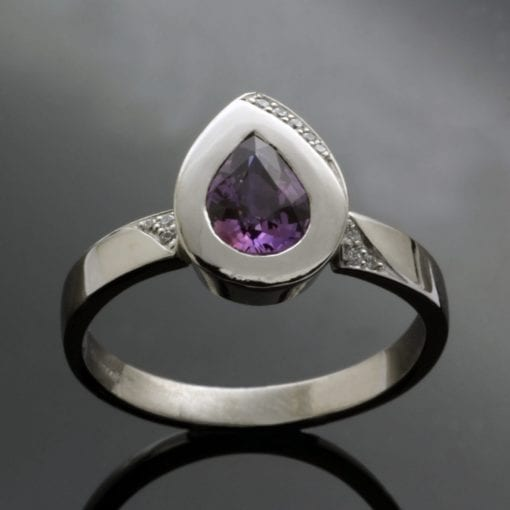 Pear cut Purple Sapphire gemstone set in Platinum contemporary statement ring
