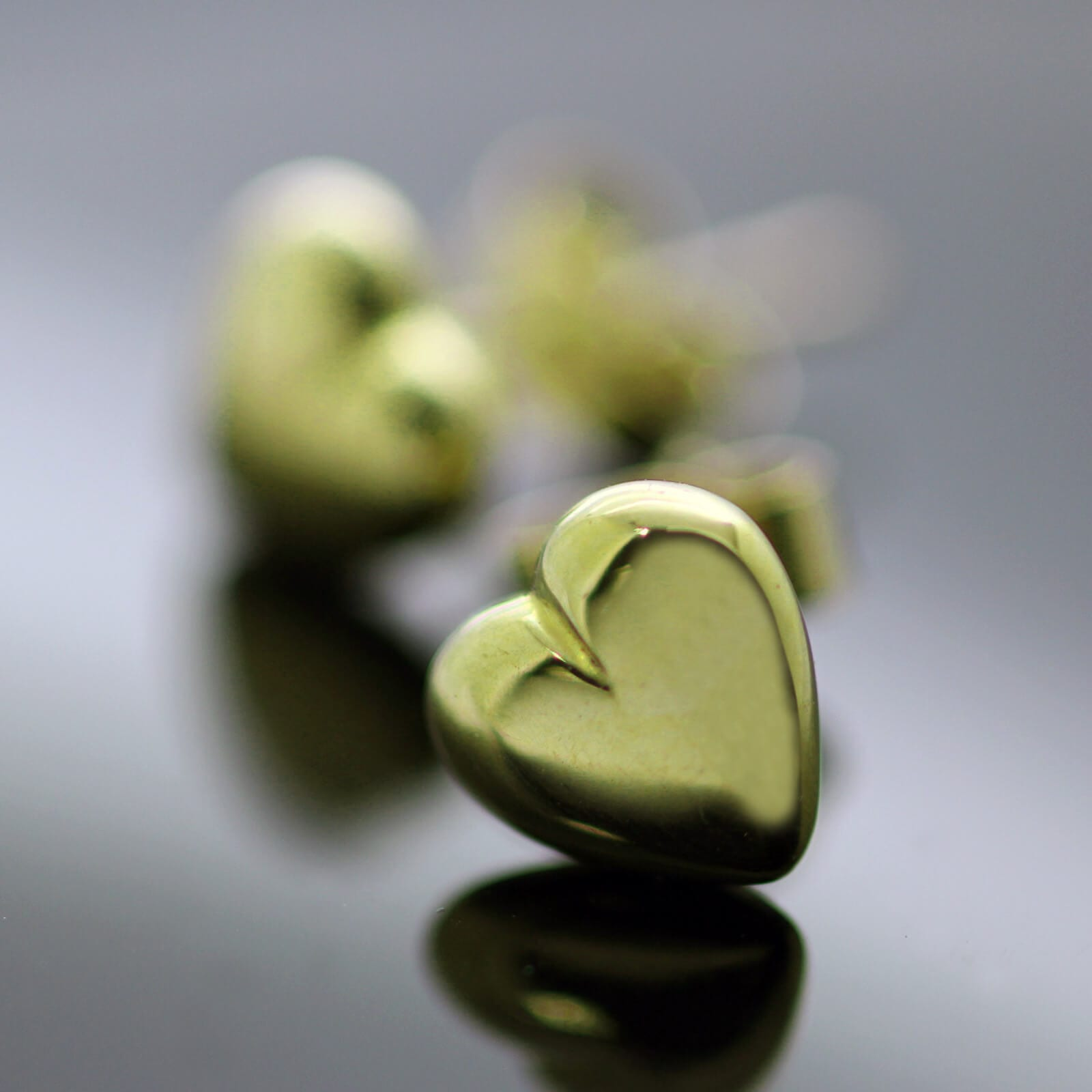 Contemporary solid Yellow Gold modern heart stud earrings