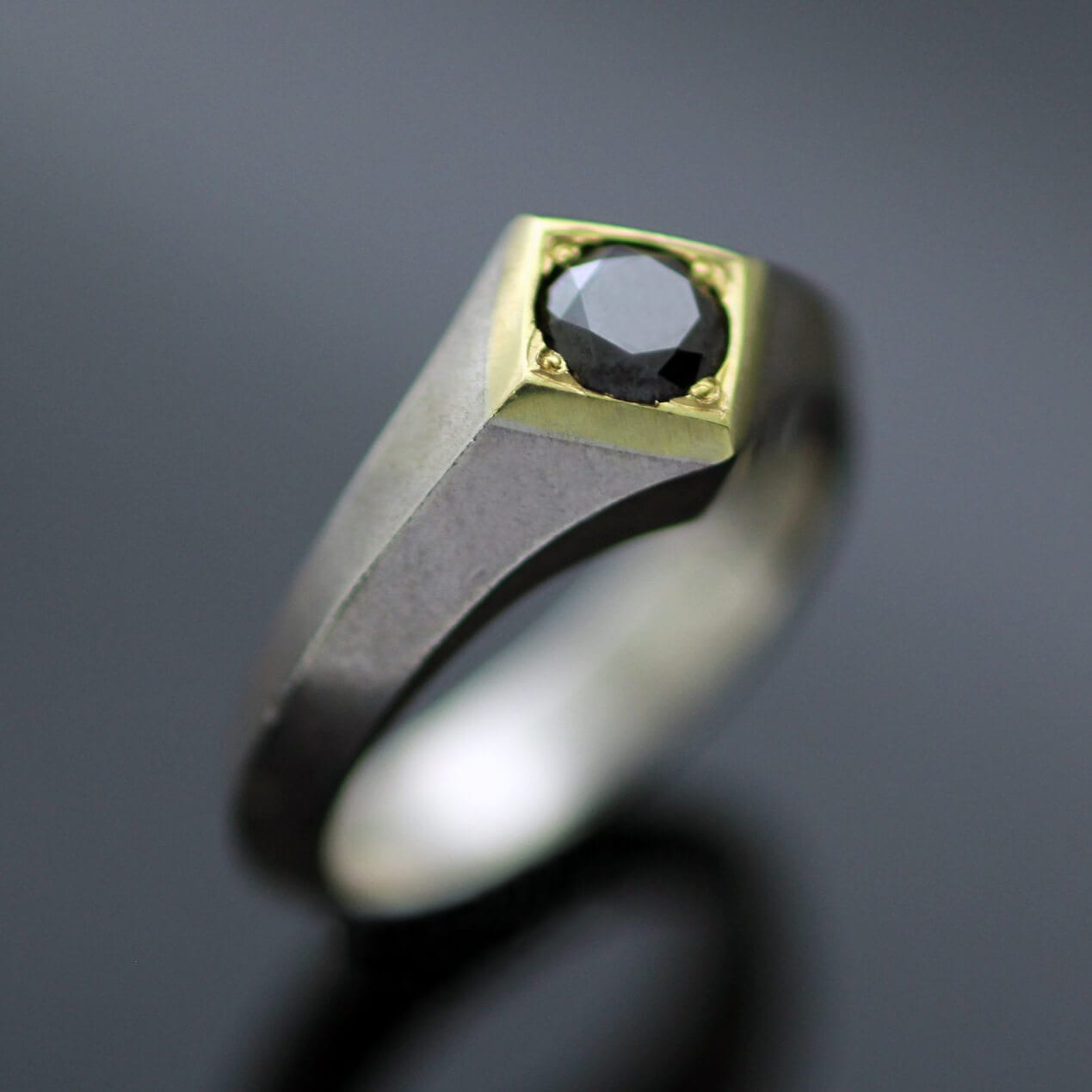 Round Brilliant Black Diamond set in 18ct Yellow Gold on sleek modern Silver handmade ring shank