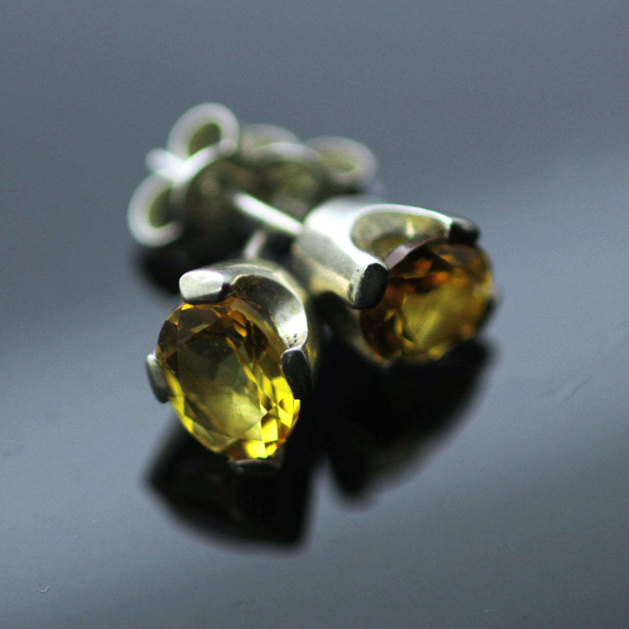 Oval cut Citrine gemstones set in modern Silver stud earrings
