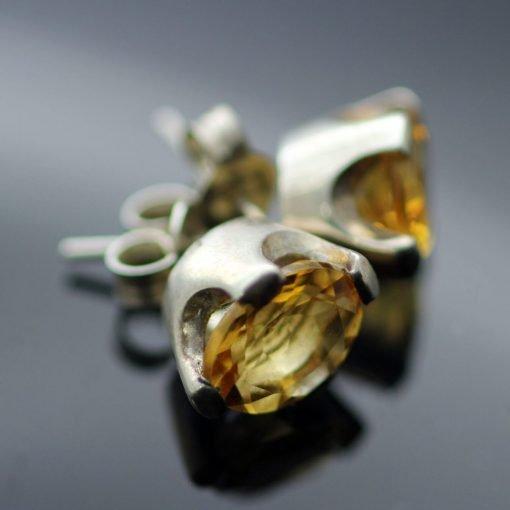 Oval cut citrine gemstones set in solid Sterling Silver stud earrings