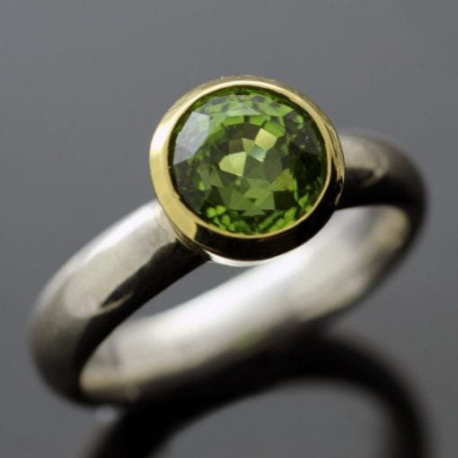 Round Brilliant Peridot gemstone collet set in Yellow Gold Sterling Silver ring