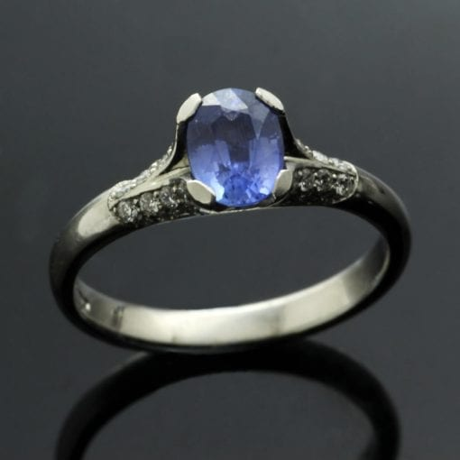 Cornflower blue Oval cut Sapphire with pave set Diamonds unique modern engagement ring by Julian Stephens