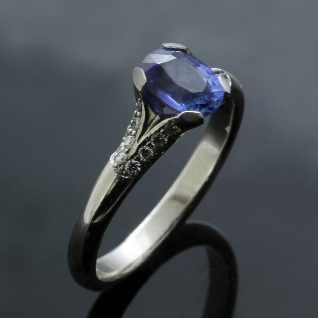 Cornflower Blue Sapphire and Diamonds handcrafted elegant engagement ring by Julian Stephens