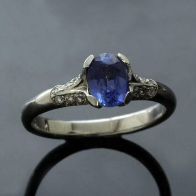 Stunning engagement ring with Oval cut Sapphire with shoulders of pave set Diamonds