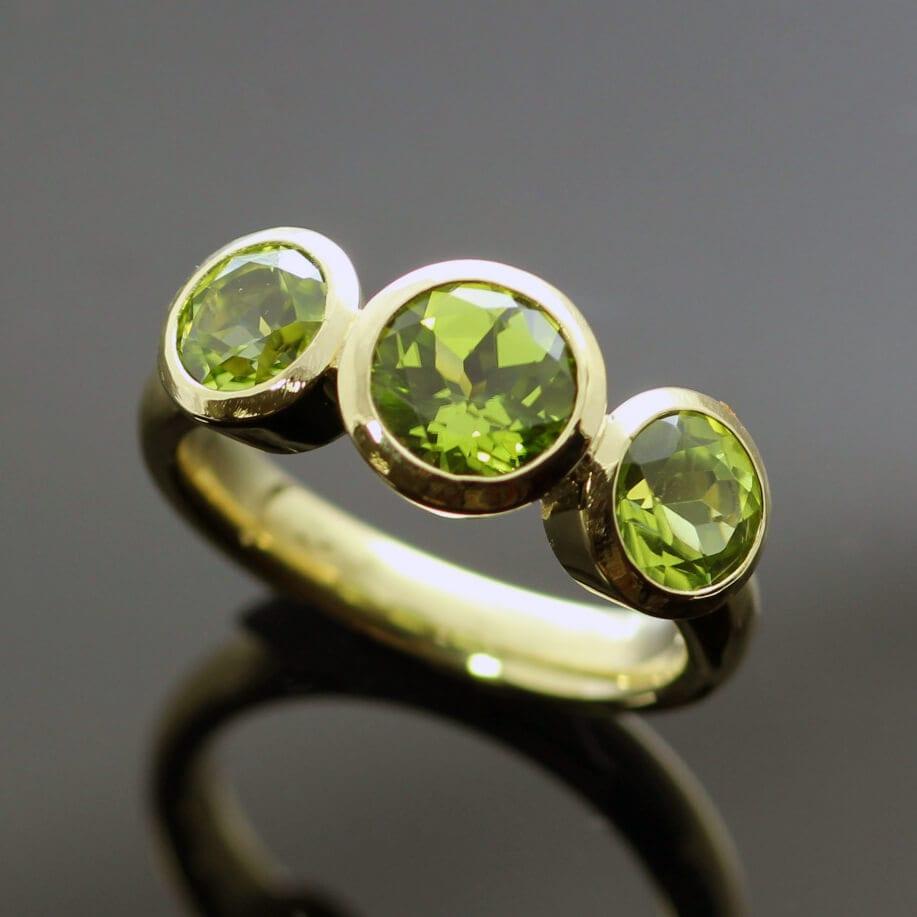 Bespoke handmade Peridot gemstone Yellow Gold Trilogy ring