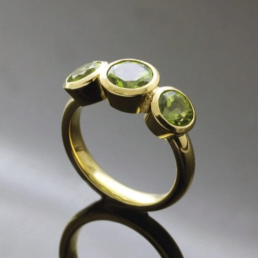 Handmade Bespoke Peridot Trilogy ring in Yellow Gold