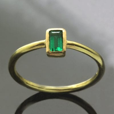 Handmade modern stacking ring in Yellow Gold with Baguette cut Emerald gem