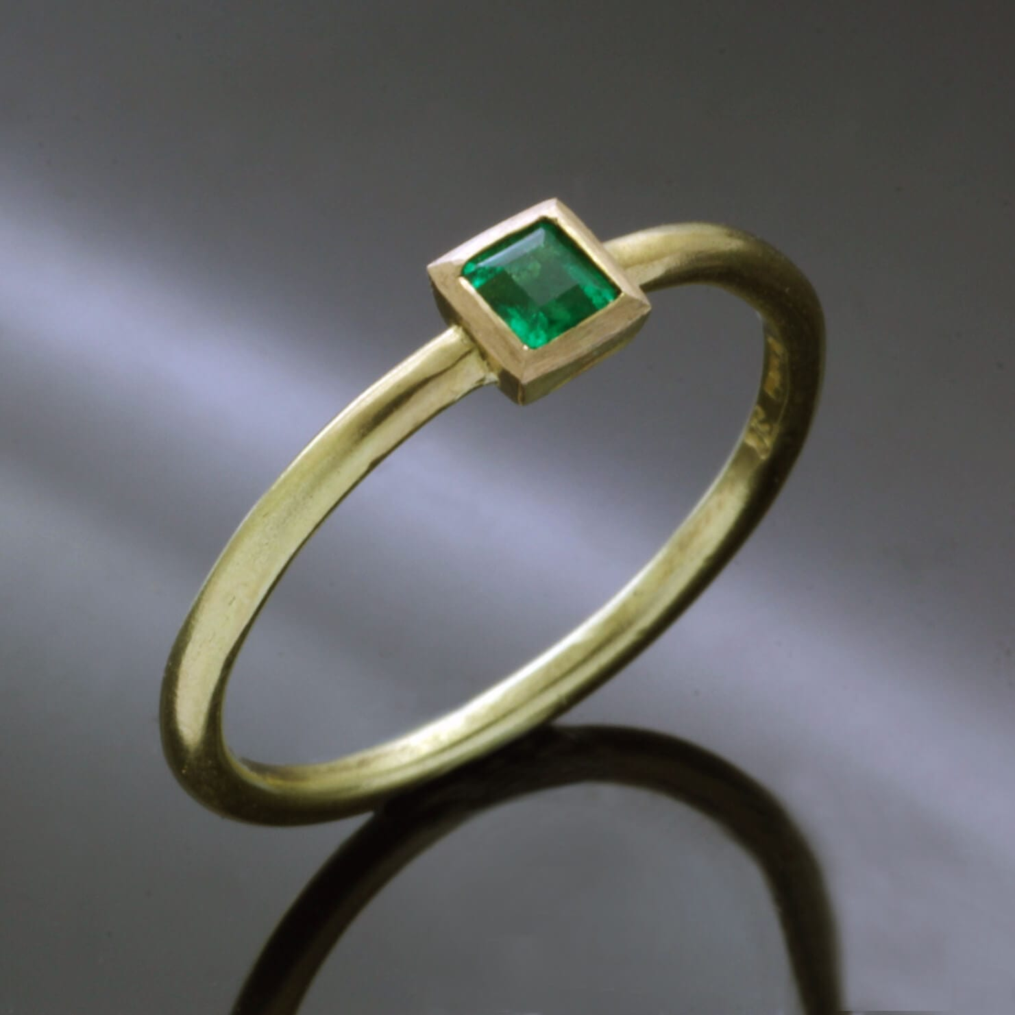 Handmade Yellow Gold stacking ring with Square cut Emerald gemstone