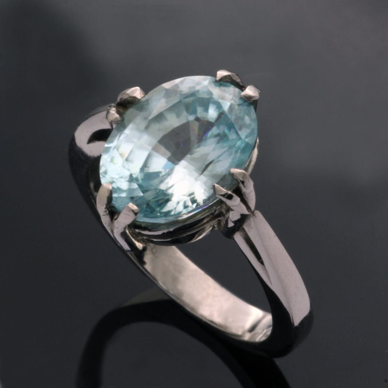 Modern dress ring with Zircon gemstone set in Palladium
