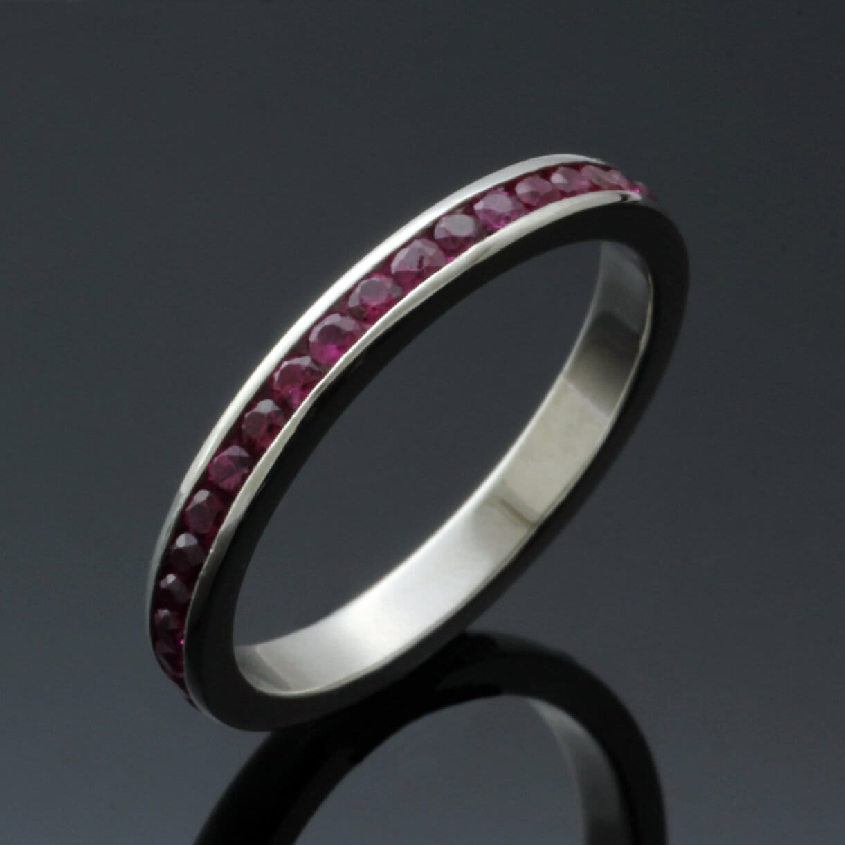 Bespoke platinum half eternity band with Ruby gemstones