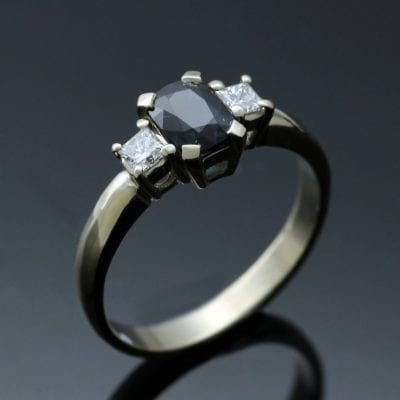 Cushion cut Sapphire, Princess cut Diamonds set in 18ct White Gold Trilogy ring