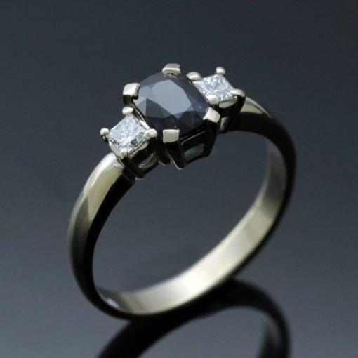 Cushion cut Sapphire, Princess cut Diamonds set in 18ct White Gold Trilogy ring