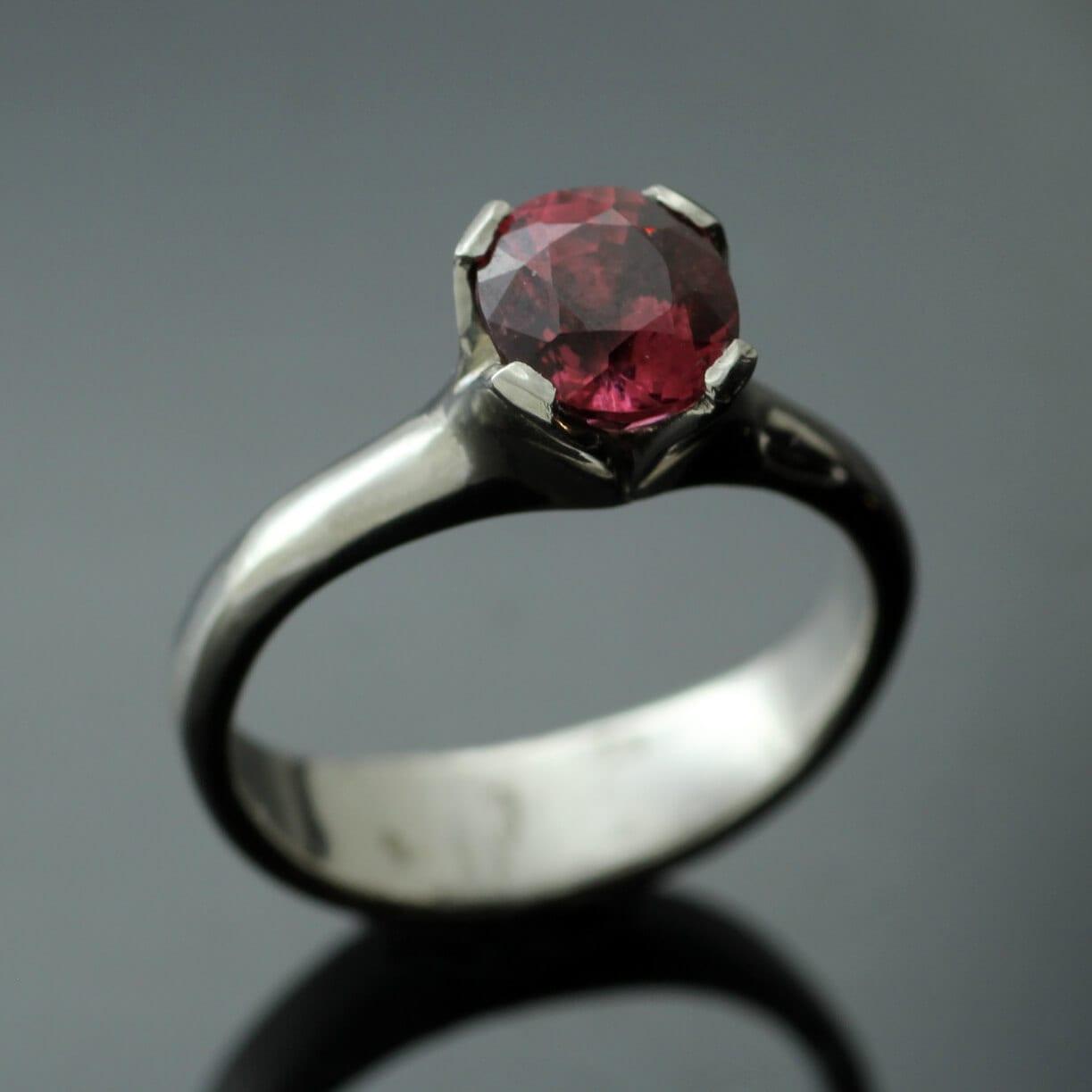 Peach Spinel gemstone set in modern Palladium Flower engagement ring