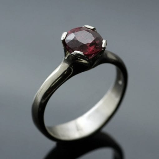 Peach Spinel set in Palladium modern Flower engagement ring