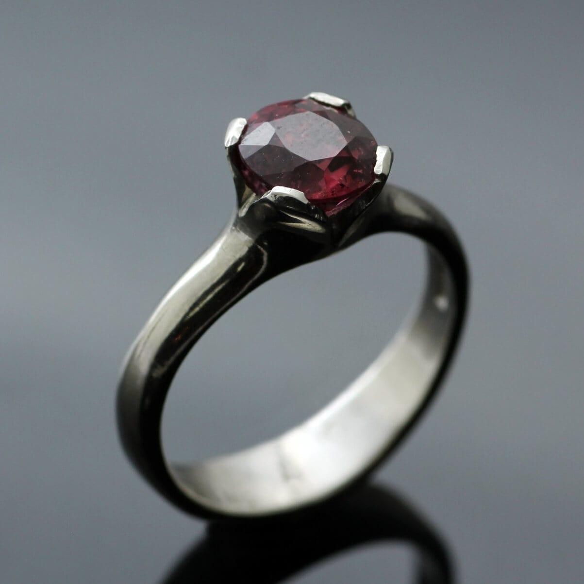 Peach Spinel set in Palladium modern Flower engagement ring