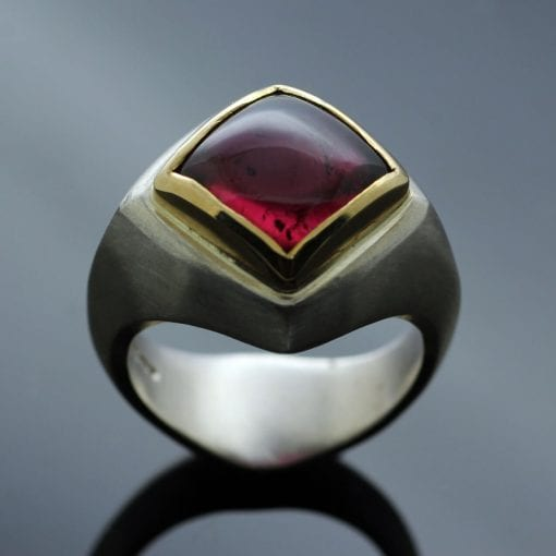 Hot pink Tourmaline Abbey ring featuring a Yellow Gold setting mounted on a sleek, modern Silver shank