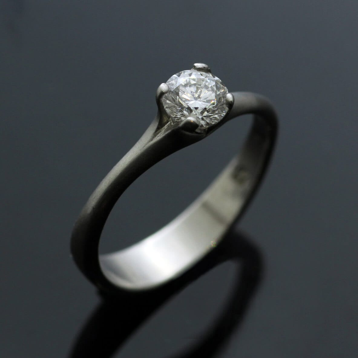 Platinum and Round Brilliant Diamond contemporary engagement ring