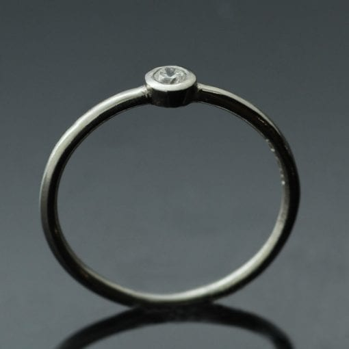 Platinum and Round Brilliant Diamond handmade engagement ring by Julian Stephens