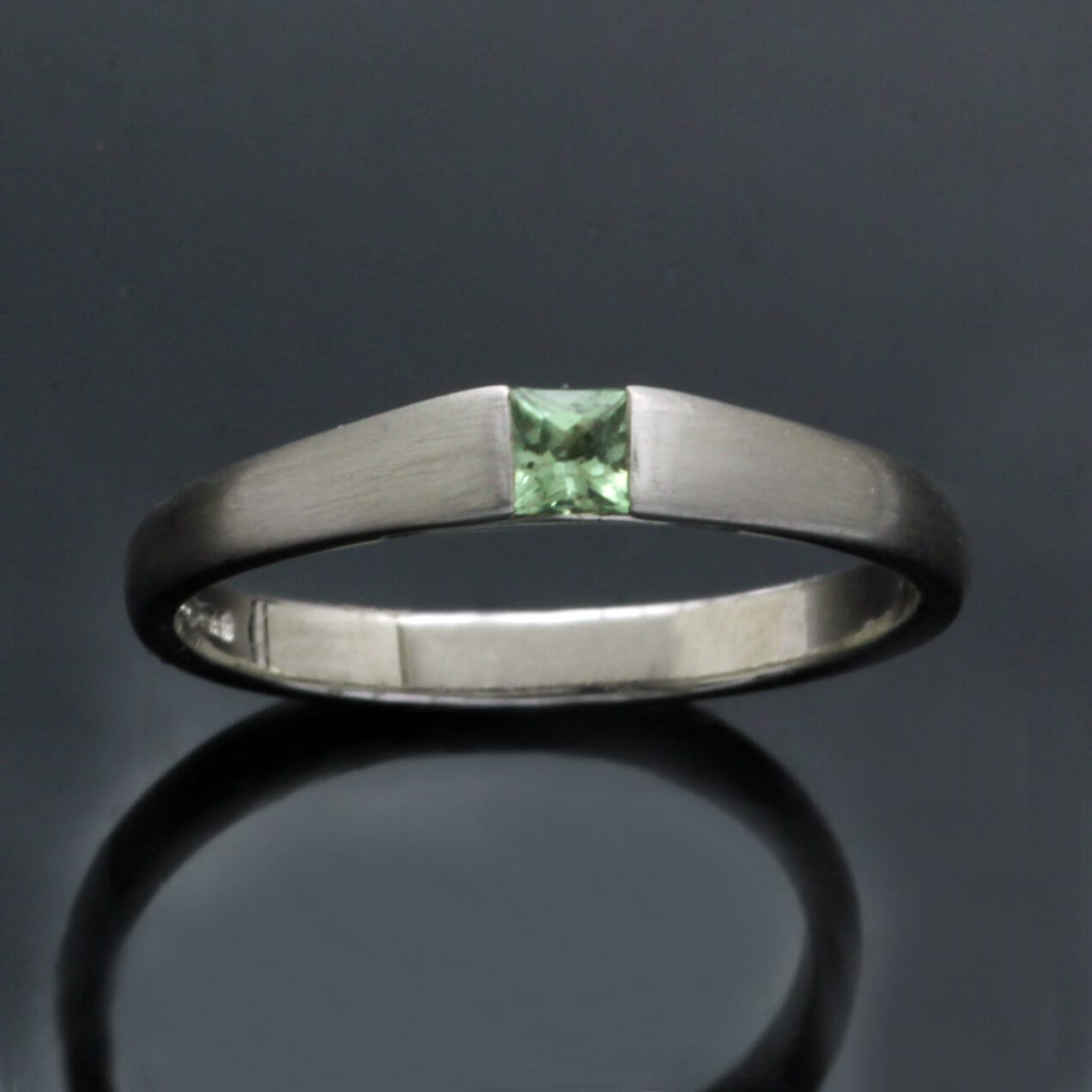 Handmade Green Sapphire and Platinum contemporary engagement ring