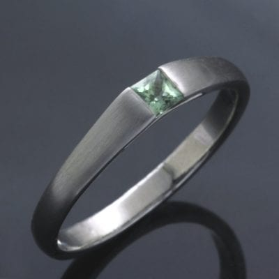 Unique, handcrafted engagement ring with Pale Green Sapphire set in Platinum