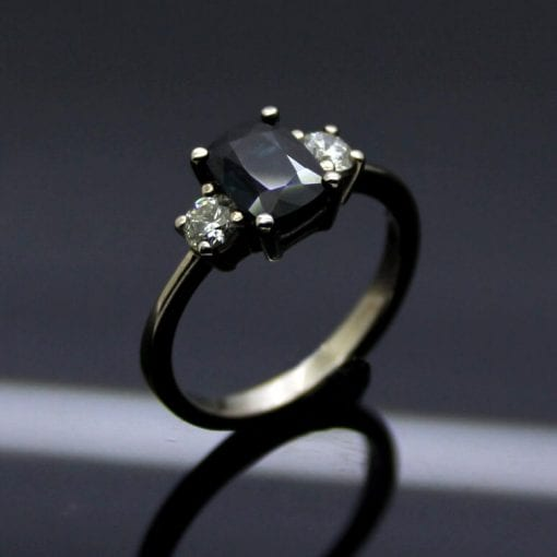 Cushion cut Sapphire with Princess cut Diamonds set in White Gold engagement ring