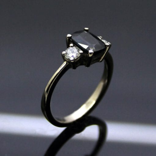 Trilogy ring with sapphire, diamonds and white gold