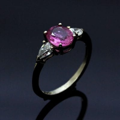 Modern Trilogy engagement ring with Pink Sapphire and Pear cut Diamonds