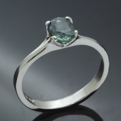 Bespoke Platinum engagement ring with Teal colour change Sapphire